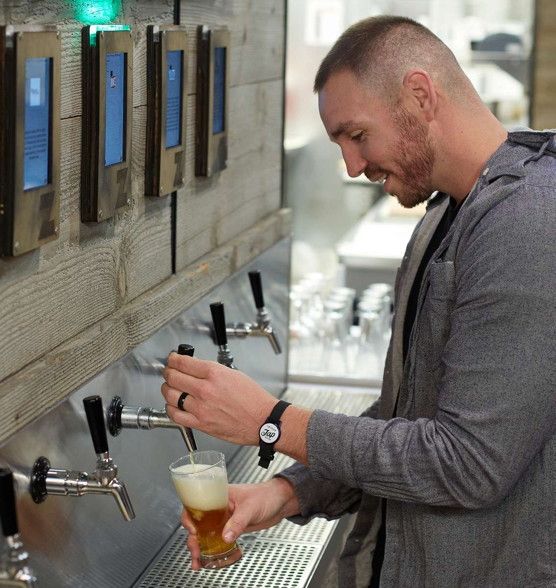 pouring beer from wall