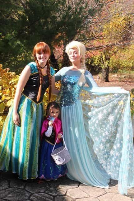 women dressed as frozen characters