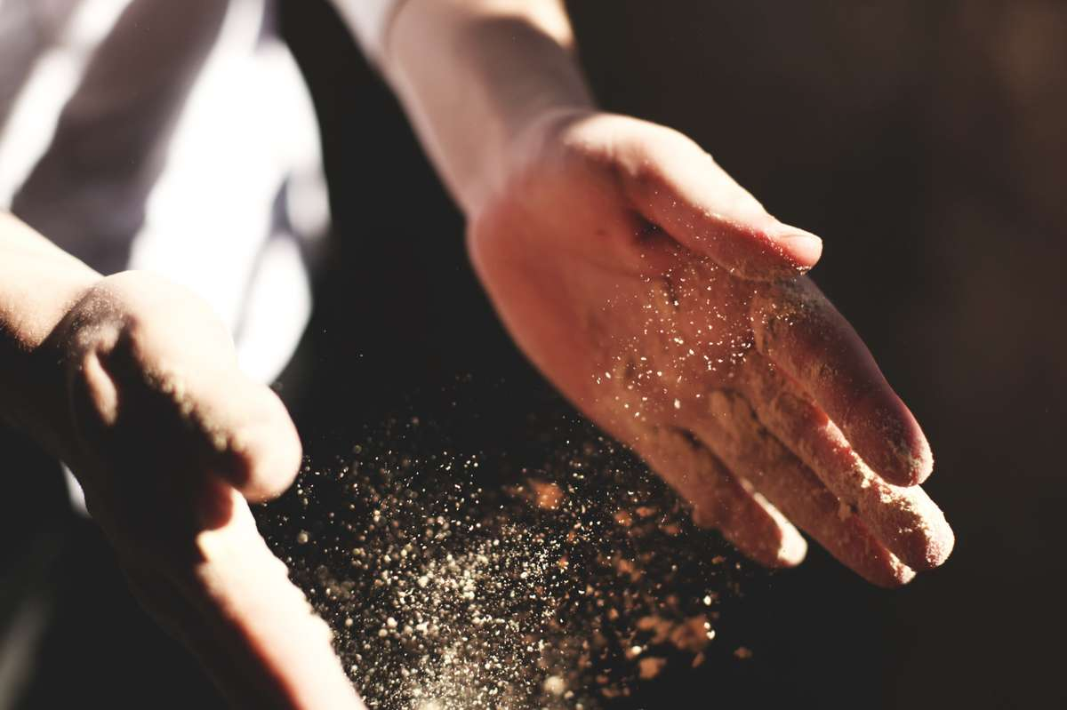 Chef dusting flour from his hands