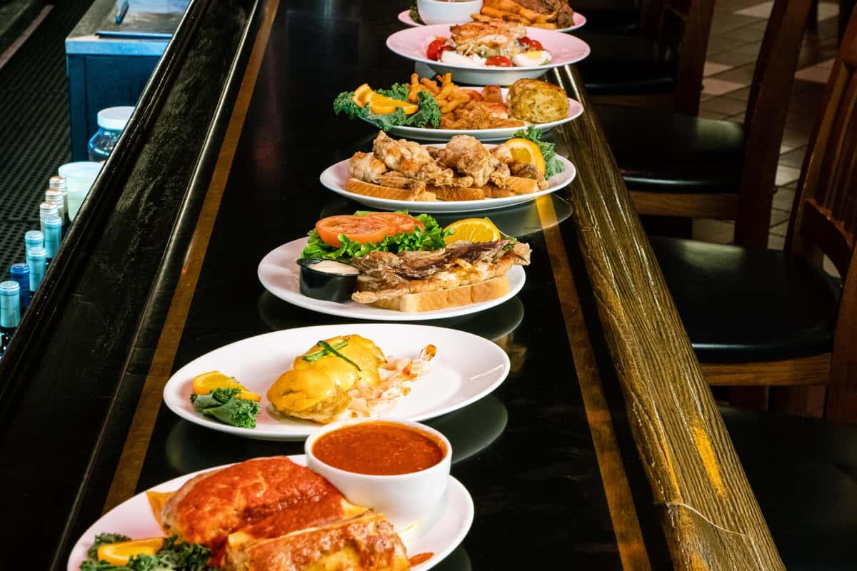 several plates of food along a bar