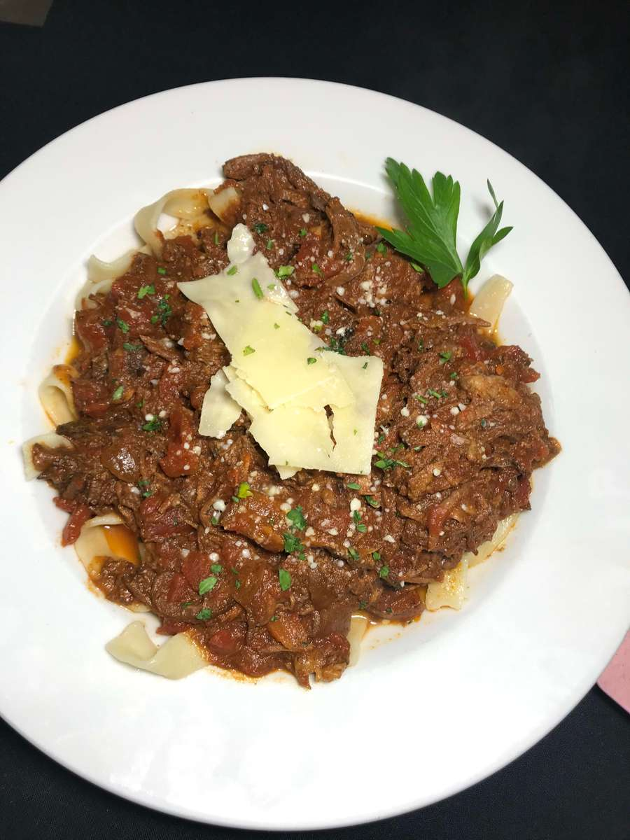 Braised Beef Over Pasta