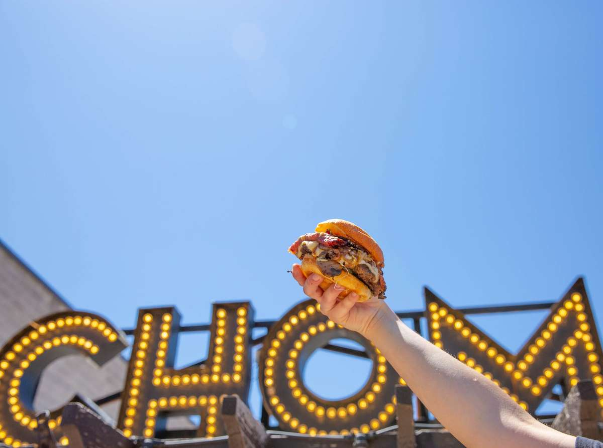 burger in front of Chom sign