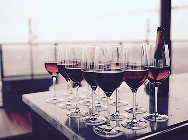 multiple glasses of red wine on table