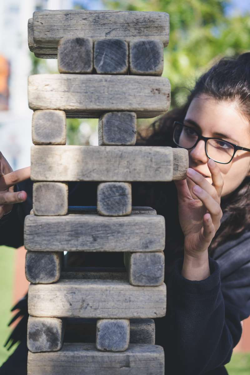 woman playing jenga