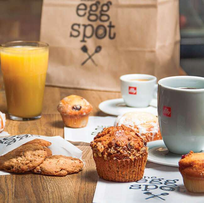 spread of bakery items and beverages