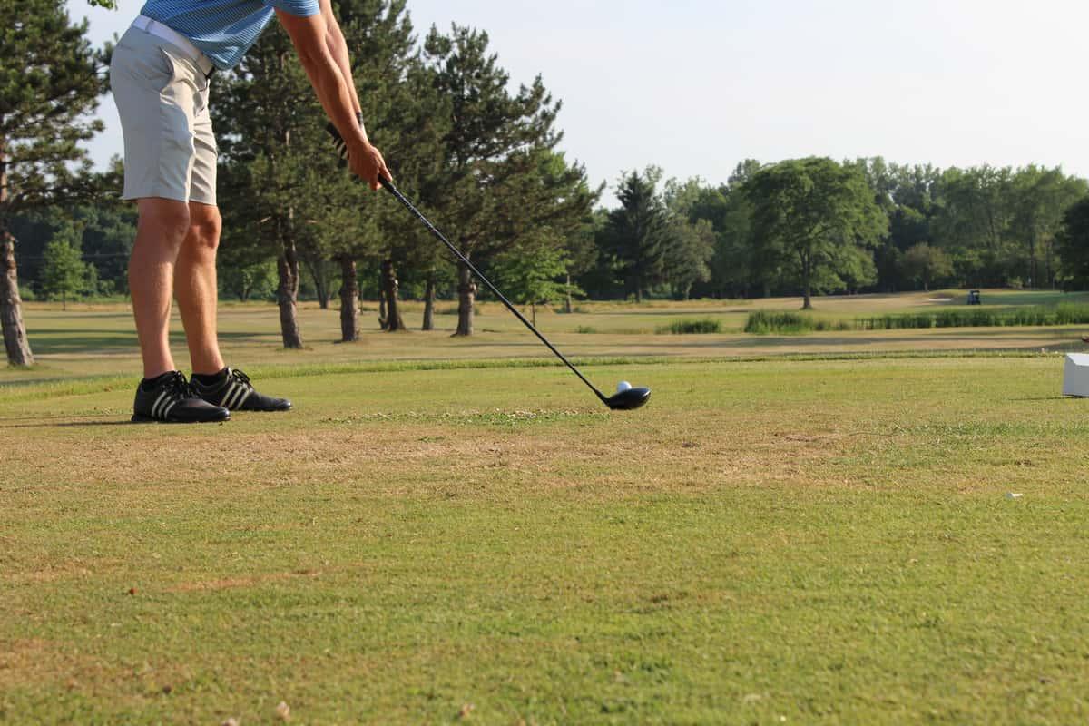Golfer preparing to hit a golf ball
