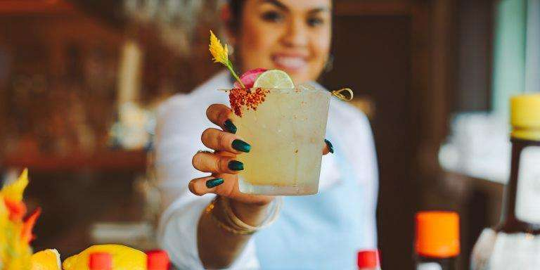 waitress holding a cocktail drink