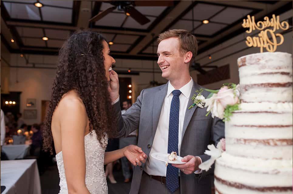 Bride and groom enjoying their wedding cake
