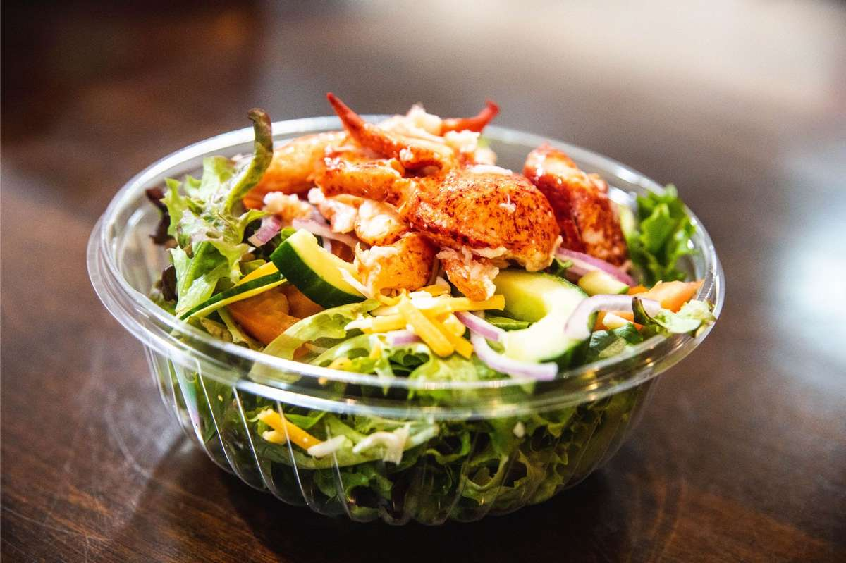 House salad topped with Lobster meat