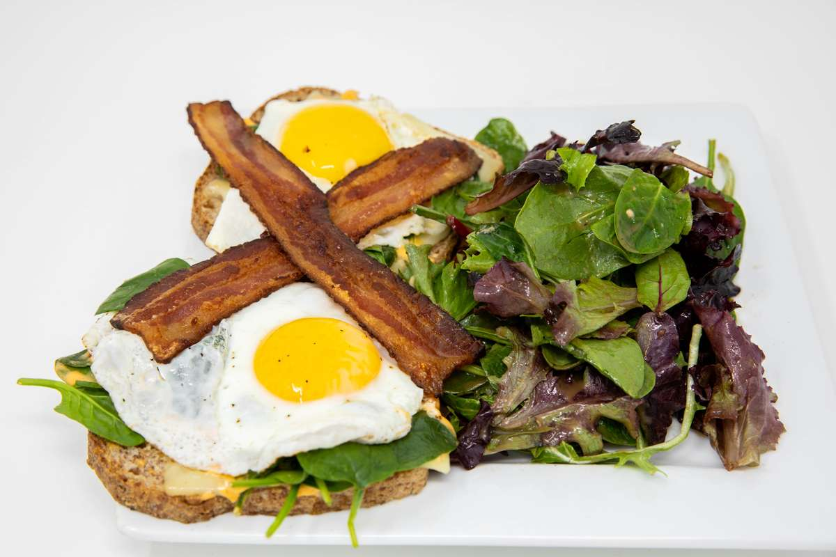 Fried egg sandwich with greens