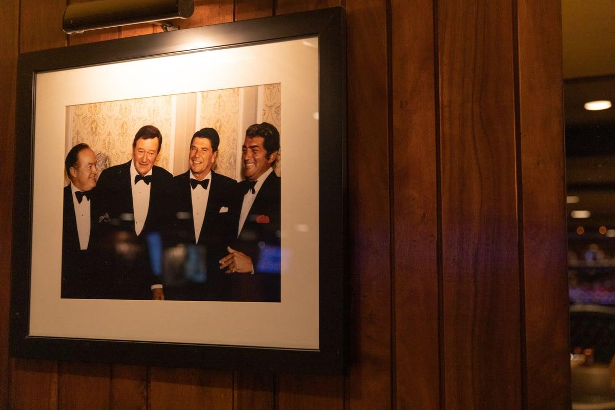 interior photo of four men