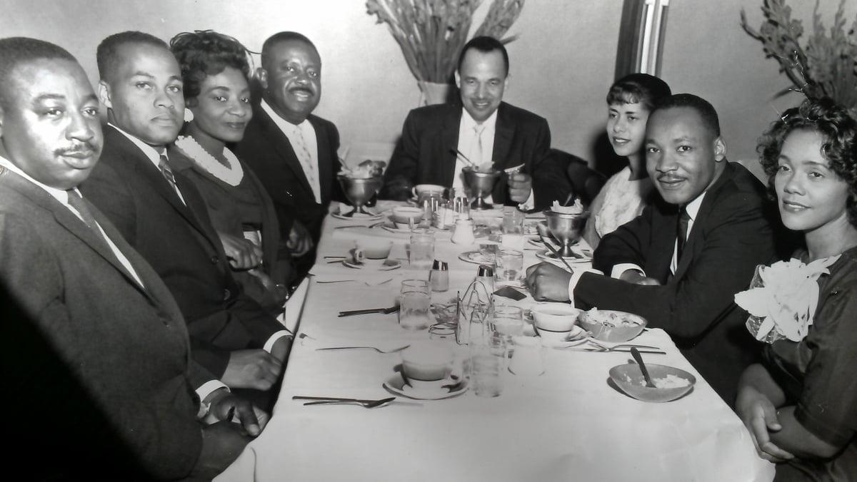 Rev. Fred Bennett, Mr. Isaac Farris, Sr., Mrs. Christine King Farris, Rev. Ralph D. Abernathy, Dr. Roy C. Bell, Mrs. Clarice Wyatt Bell, Dr. Martin Luther King, Jr., Mrs. Coretta Scott King; Pascal's Restaurant, Hunter St., Atlanta, GA. ~1962 — Photo via Dr. Clarice Bell on Flickr