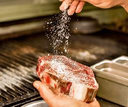 steak being salted