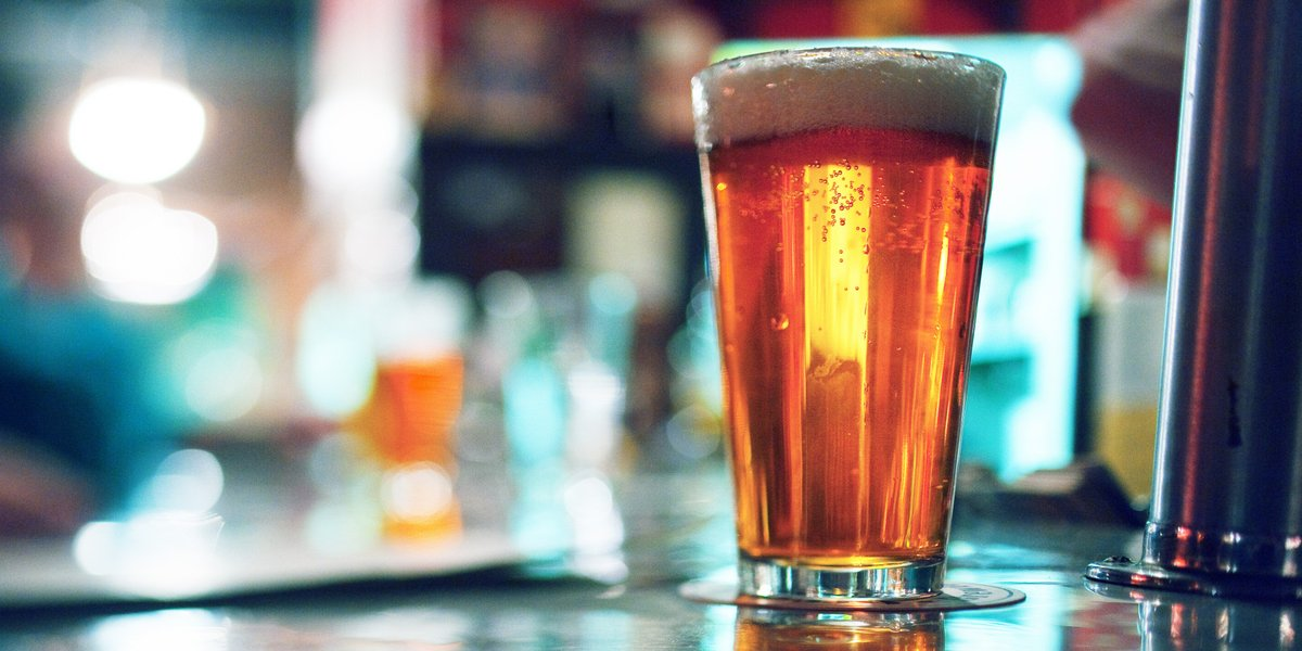 focused beer against blurry background