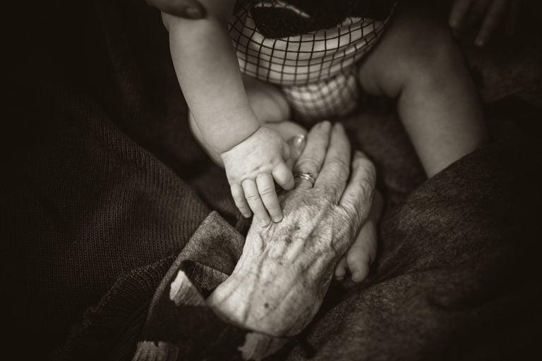 Baby holding someone's hand