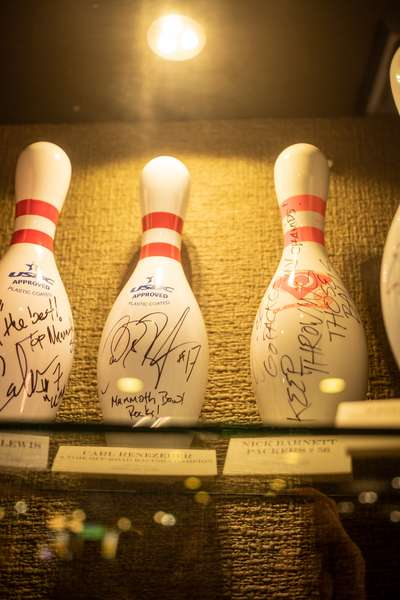 Signed bowling pins in a display case