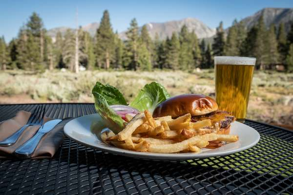 Burger on a table with a mountain view