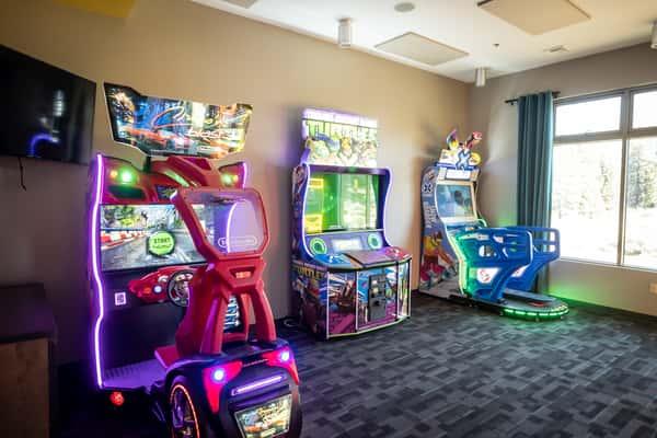 Three arcade games near bowling alley