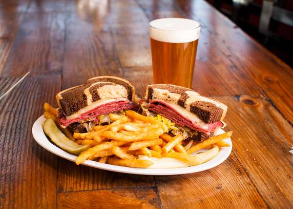 pastrami sandwich with fries
