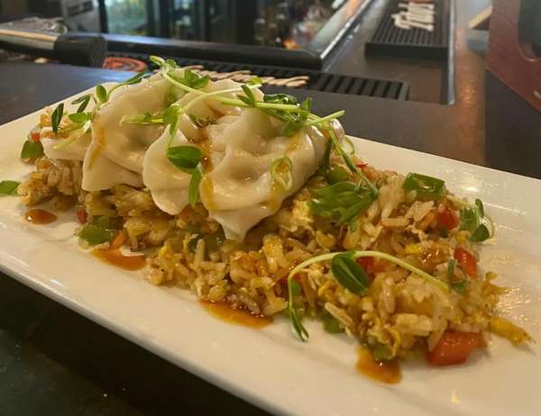 Potstickers over Fried rice