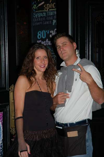 Couple posing at an event at Liam Fitzpatrick's