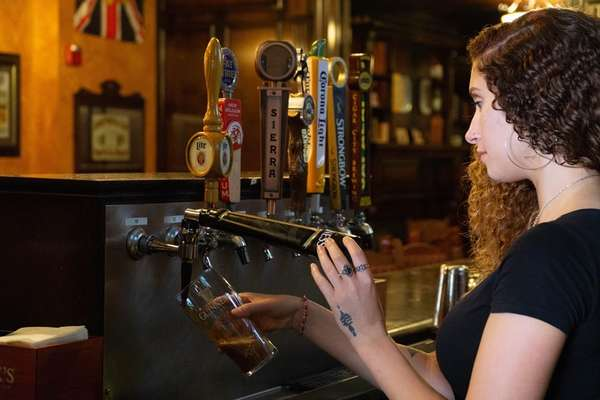 Staff pouring beer from a tap