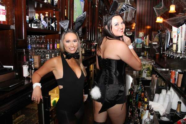 Ladies in playboy bunny costumes at an event at Liam Fitzpatrick's