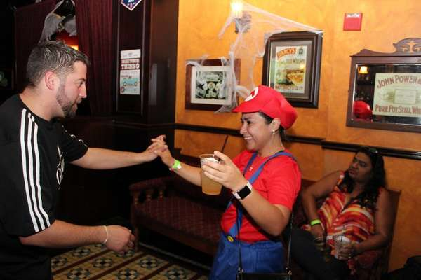 Lady dressed as Mario at an event at Liam Fitzpatrick's