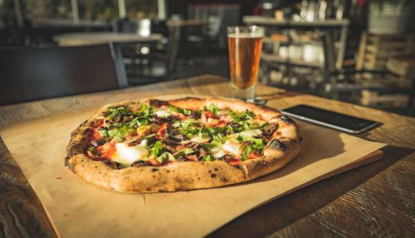 dinner-for-one-of-wood-fired-pizza-paired-with-cold-beer