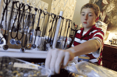 boy making jewelry