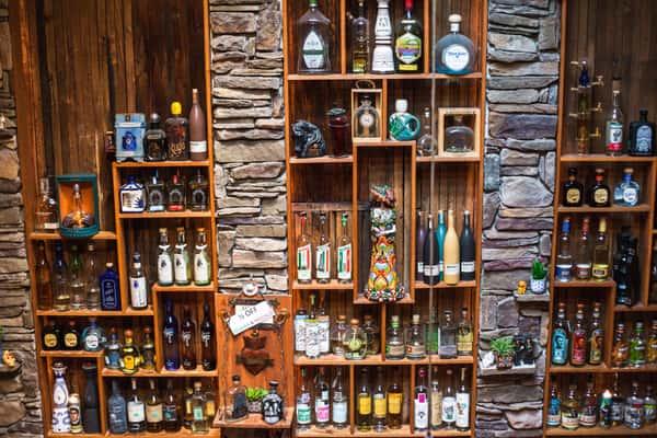 interior bar with wall of liquors