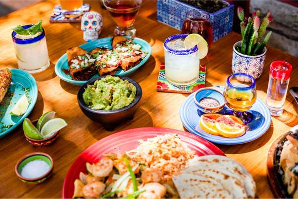 assorted mexican dishes and margaritas