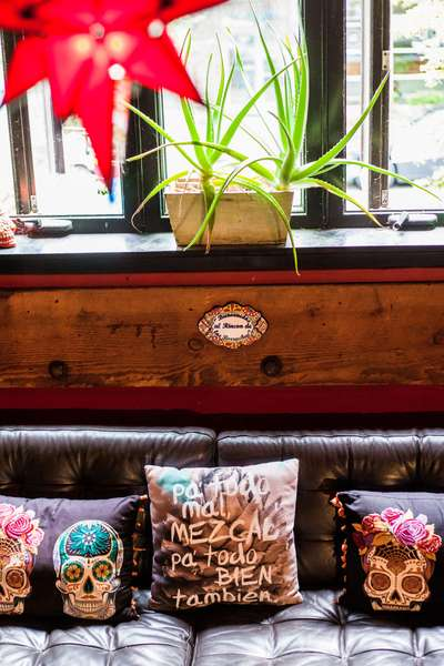 bar seating with mexican designed pillows