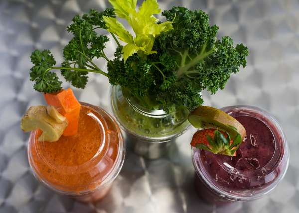 blended drinks topped with vegetables