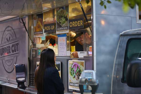 Customer ordering from the Upper Cut food truck
