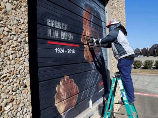 Artist painting a mural for President Bush Sr.