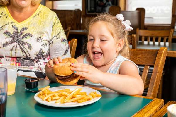 little girl with burger