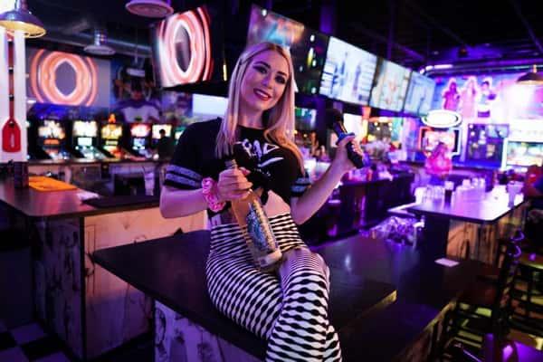 bartender holding drinks