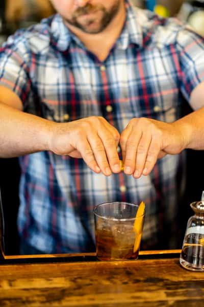 bar tender squeezing juice