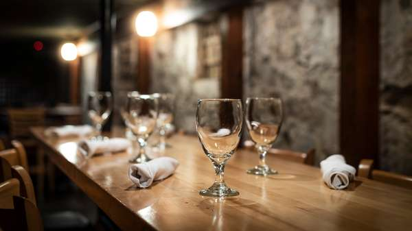 Interior ambiance - wine glasses set on table with silverware