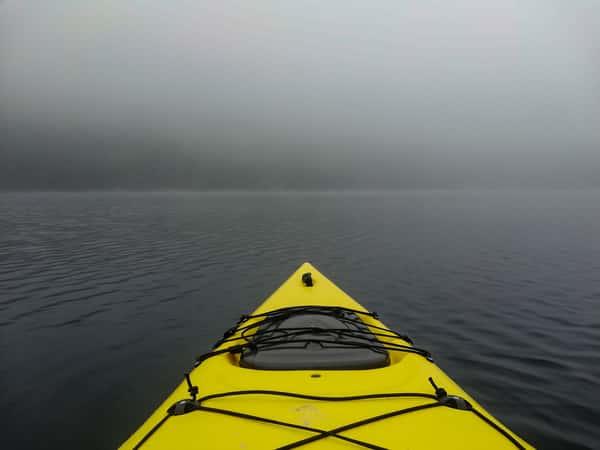 kayak on river with fog