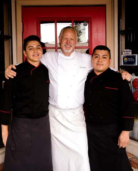 Chefs at Montalcino Ristorante Italiano posing infront of the restaurant holding an award