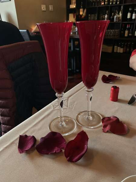 Red drinks with rose petals