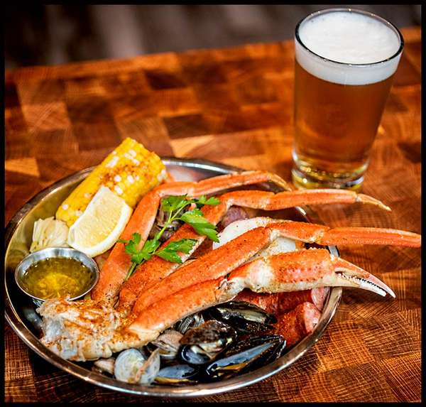 raw seafood and a beer