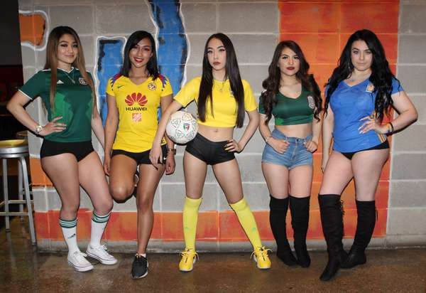 five girls in sports attire
