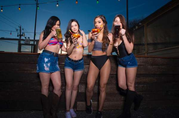 four girls holding drinks