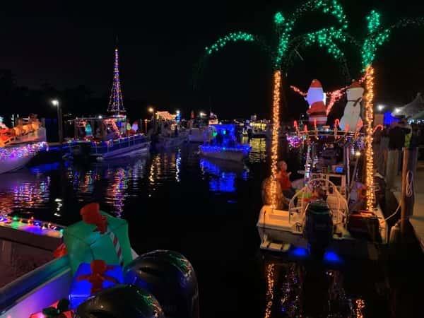Boats at night surrounding Whitey's