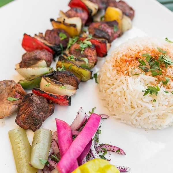 kabobs with rice and veggies