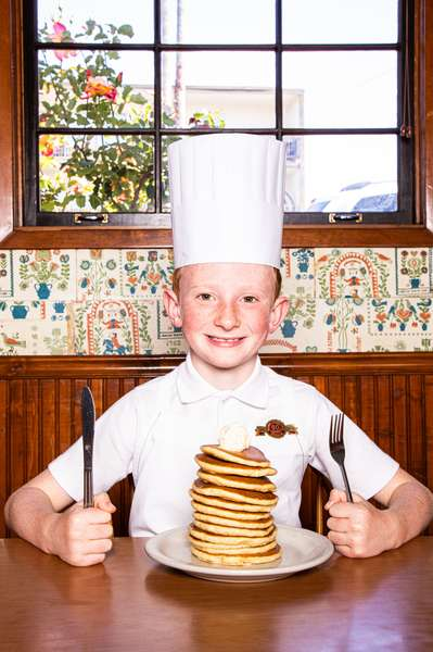 boy chef with pancakes