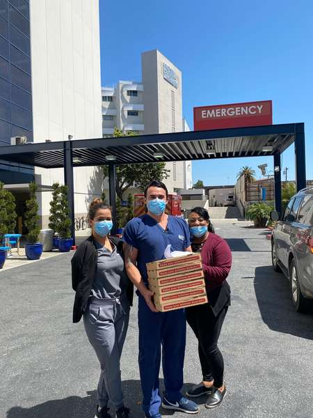 First Responders at Southern California Hospital at Culver City - Emergency Department receiving pizza delivery